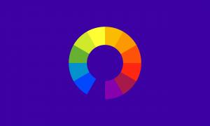 Um fundo índigo com uma roda de cores em seu centro. A cor índigo cria um espaço na roda de cores.